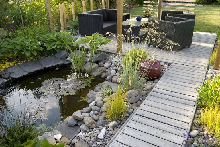 landscaping in different ways with pebbles and mulch